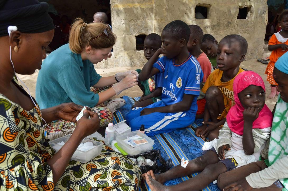 A Projects Abroad volunteer provides medical treatment to talibe children in Senegal.